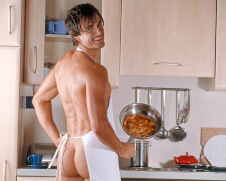 IMG BANK FAIL - Naked man wearing only an apron in the kitchen Getty Images/Altrendo