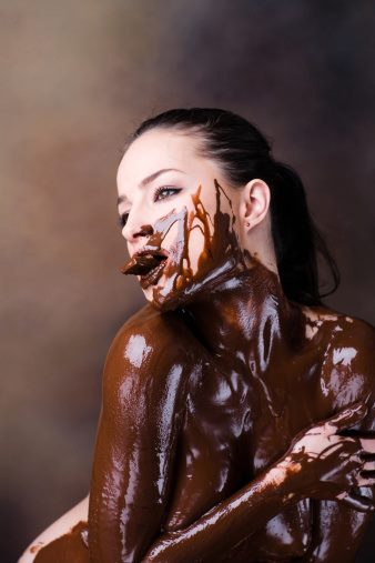 IMAGE BANK FAIL Naked Young Woman Covered in Melted Chocolate and Eating Getty Images Vetta