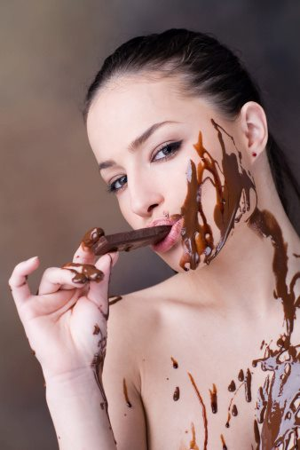 IMAGE BANK FAIL Young Woman Eating Chocolate Bar and Covered In It Getty Images Vetta