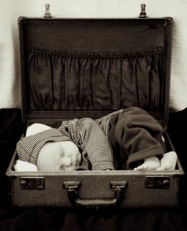 IMAGE BANK FAIL baby in a suitcase Getty Images Vetta
